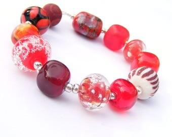 Handmade lampwork glass bead set of 12 red renegade beads - lampwork orphan beads