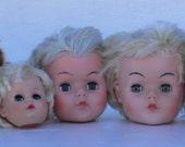 group of doll heads, creepy dolls, baby parts, sleepy eyes, doll hair, from Diz has Neat Stuff