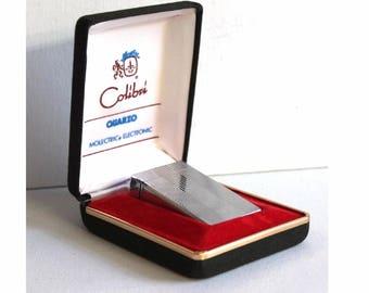 Vintage Colibri pocket lighter. Colibri pocket gas lighter in original box