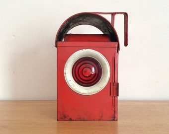 Vintage red metal signaling lantern, railway lantern or road lantern with red and green lenses