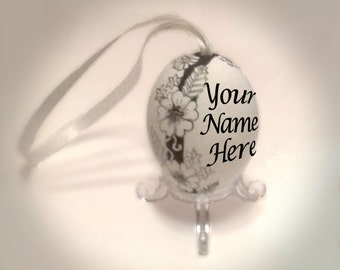 Personalised Black & white floral egg ornament. Hollow eggshell, decorated with hand-painted pattern of flowers and the name of your choice