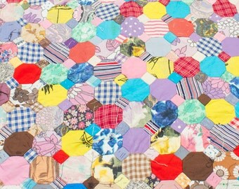 patchwork quilt this is an unfinished vintage piece made with hexagon shaped patches from the 1950's and 60's.