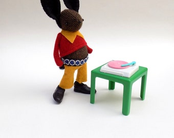 Woollen Disco Bunny  -  Handmade plush rabbit wearing yellow felt flares, a bright red pullover and plastic shoes.