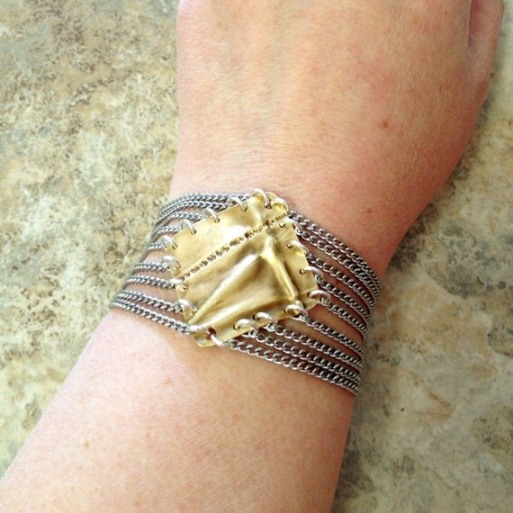 diamond shaped brass fold form bracelet with stainless steel chain