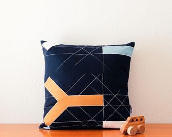 Black pillow cover with minimal abstract lines and shapes