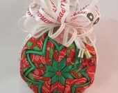 Quilted fabric Ornament - Christmas ornament - Red fabric with poinsettia and white scroll design, white bow, and two Christmas light bulbs