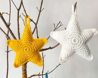 Hand-crocheted star-shaped Christmas tree decoration in soft wool