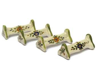 Set of 4 Hand Painted Flower Pottery Knife Rests.