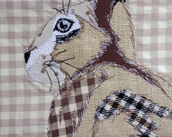 Patchwork free motion embroidered rabbit/hare cushion