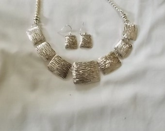 319.  Silver Tone Necklace and matching ear wire Earrings