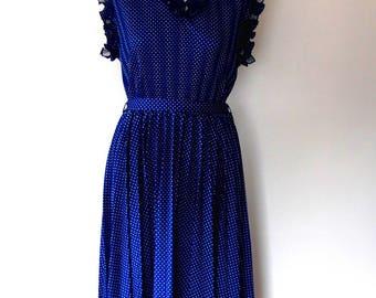 Polka dot tea dress / dark blue / white / frill / ruffle / vintage / 1950s style / rockabilly / belted / midi length / sleeveless dress