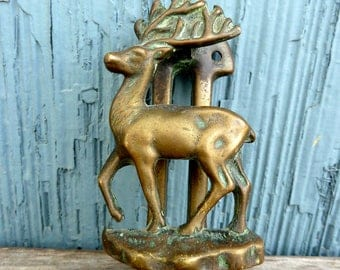Lynton brass door knocker featuring stag deer, country cabin style with vintage patina