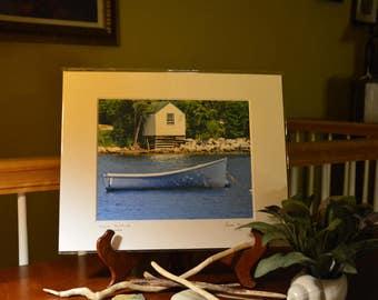 Boat house with docked boat, Bay of Fundi, Canada, Nova Scotia