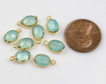 Petite tiny crystal charms 6*8mm. Aquamarine Chalcedony Opal crystal aqua quartz Ovals bezeled with gold plated copper / brass. 8 pieces.