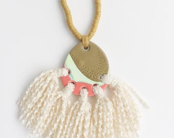 Polymer clay pendant with tassels