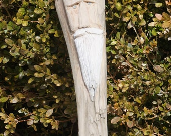 Santa carved into driftwood
