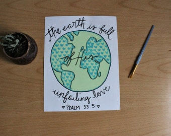 """Earth Painting - A painting of a bright green and aqua earth with hearts and the verse Psalm 33:5, 8.5""""x11"""" Acrylic on cardstock."""