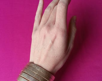 Stylish gold leather bracelet, sliced leather cuff, comfortable wristband, elegant golden metallic cuff