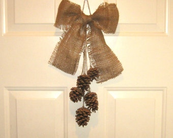 Pine cone swag with burlap bow -- natural rustic home decor