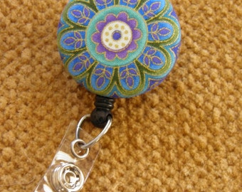 Flower badge reel, retractable badge holder