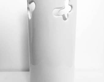 White ceramic vase with butterflies