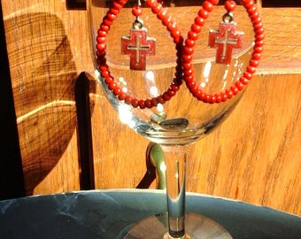 red earrings with cross