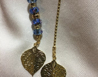 Blue beaded light and fan pull set with gold chains