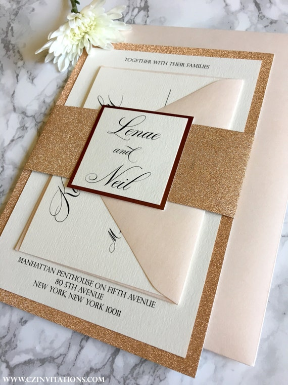 gold glitter wedding invitation with glitter belly band
