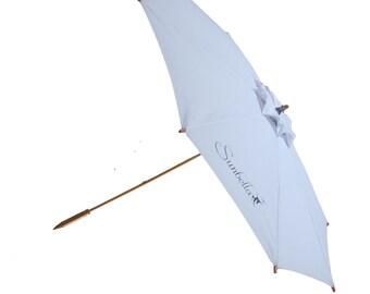 Sun umbrella with wooden handle. White elegant, Sunbella Coast sun parasol. Personal anti-UV umbrella. UPF 50+. Blocks 98% of UV rays. SC13W