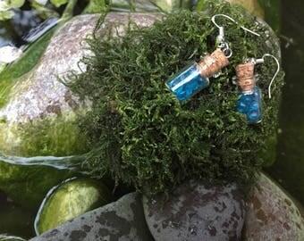 Blue gems in tiny bottles earrings