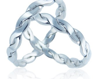 Pair of silver artisan braided 925.000 records