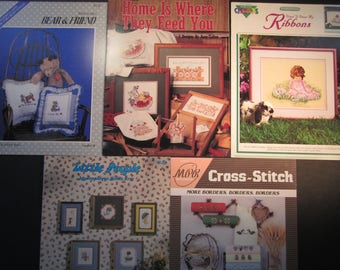 5 cute animal and child cross stitch pattern booklets, Teddy bear and friend,Home Is Where They Feed You, pigs, Bunny rabbit with girl