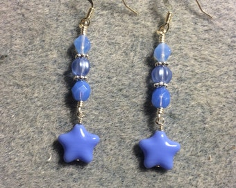 Opaque baby blue Czech glass star bead dangle earrings adorned with baby blue Czech glass beads.