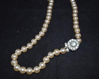 White pearl necklace / rhinestone clasp / 1950s / 23 inches / white / pearl / necklace / beaded necklace / beads / rhinestone / clasp