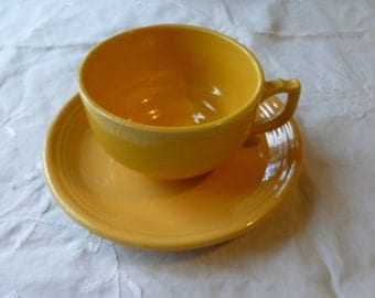 Yellow Riviera Ware cup and Fiesta saucer mash-up