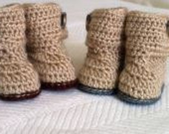 Pattern crocheted baby booties size 6-9 months.