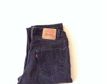 Mom jeans. W28 L31. Levis 550 jeans. Original red tab, black, highwaisted, relaxed fit , 100% cotton faded jeans.