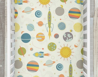 Crib Sheet / Out in Space Collection by Fabricology / Rocket / Planet / Outer Space Print / Blue / Orange / Green / Cream / Baby Boy Gift /
