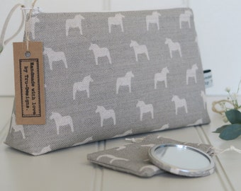 Make up bag in Olive & Daisy, Swedish Horses in Grey Blotch Linen.