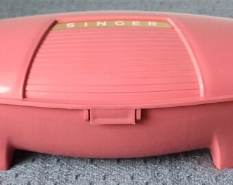SINGER ~ Buttonholer ~ Pink Plastic Case ~ No. 489500 / 510 ~ For Use on Singer Family Sewing Machines ~ ©1960
