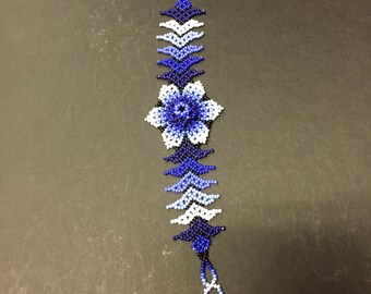 """Huichol Beaded Bracelet w/ intricate blue and white flower design (6"""" long x 1 3/4"""" wide)"""