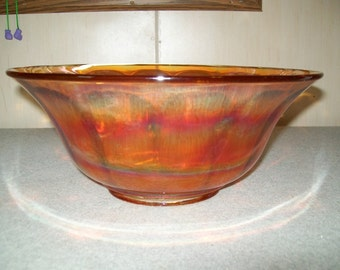Carnival Glass large fluted opalescent bowl. Bright Orange in color