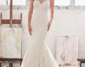 Beautifully Detailed Lace Mermaid Style Backless Wedding Gown with Chapel Train and Button Detail