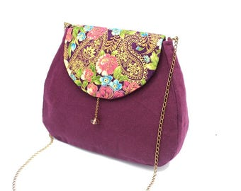 Plum messenger bag enhanced with cotton patterned with pink flowers and gold arabesques