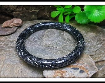 Titanium bangle resin design