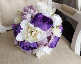 Purple, lilac and ivory silk wedding bouquet. Made with artificial roses and peonies.