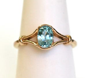Aquamarine Oval Cut Ring in 14k Yellow Gold