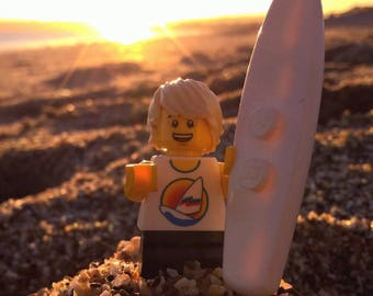 """LEGO Surfer Dude watching the sunset. 6"""" by 4"""" inch photo. Taken in Marizion Cornwall."""