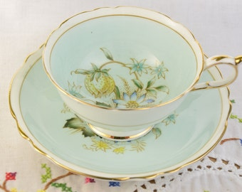 Paragon blue tea cup and saucer, hand painted double warrant
