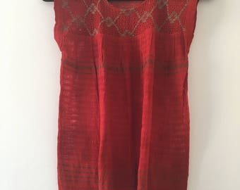 Traditional Mexican red blouse of loom with details